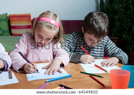 Kids drawing with crayons - stock photo