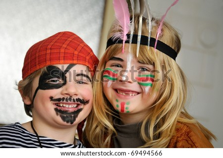 Kids dressed as little pirate and indian girl