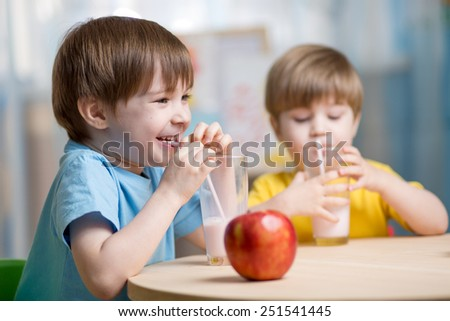 kids drinking milk at home at home or kindergarten