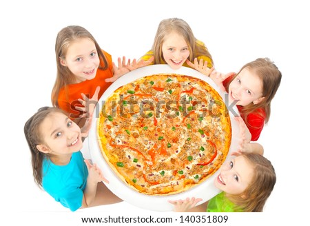 kids eating big pizza - stock photo