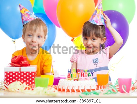 Kids - girl and boy having fun at birthday party