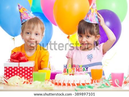 Kids - girl and boy having fun at birthday party - stock photo