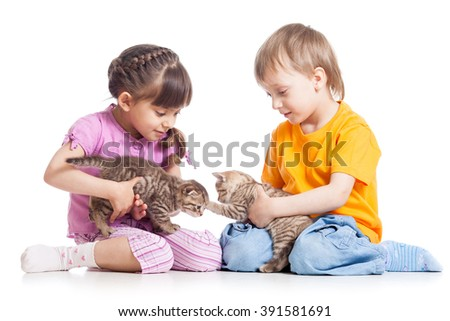 Kids girl and boy playing with kittens - stock photo