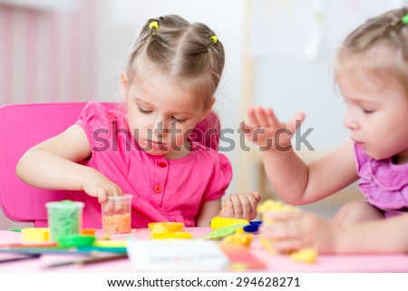 kids girls drawing and making by hands - stock photo