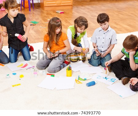 Kids group drawing and writing - stock photo