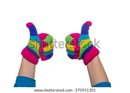 Kids hands wearing winter multicolored  gloves showing a finger gesture - stock photo