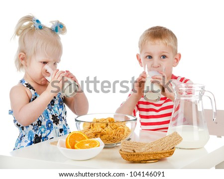 Kids having a healthy breakfast. isolated on white background