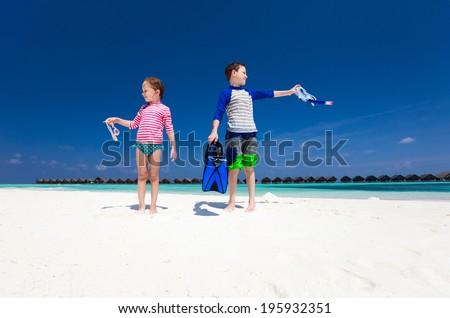 Kids having fun at beach during summer vacation - stock photo