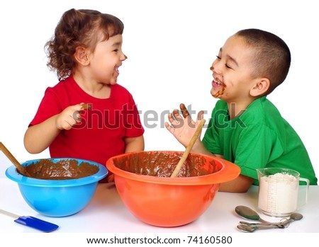 kids having fun baking, faces and fingers smeared with chocolate batter, isolated on white background - stock photo