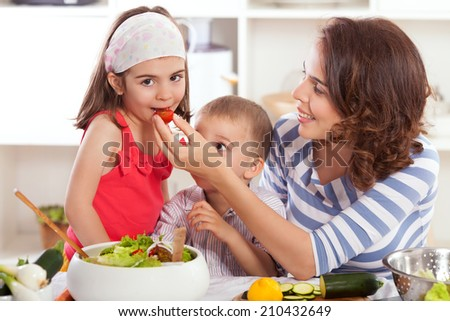 Kids having fun preparing healthy vegetarian breakfast - stock photo