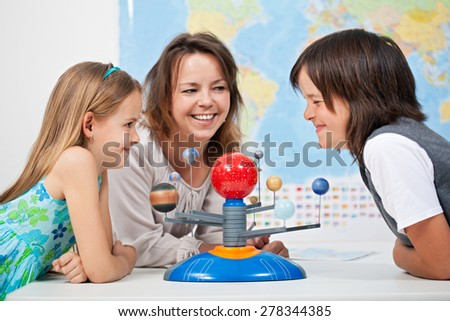 Kids having fun studying the solar system - science is fun concept - stock photo