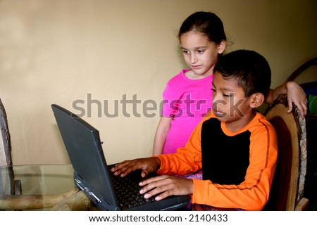 Kids having fun with a Laptop
