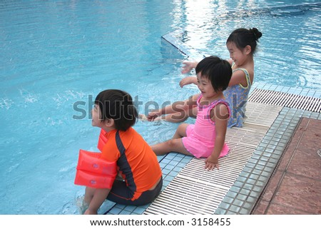 Kids having great time at the swimming pool - stock photo