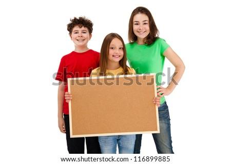 Kids holding blank noticeboard isolated on white background - stock photo