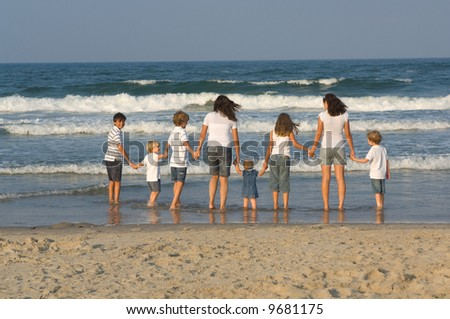 Kids Holding Hands at Beach - stock photo