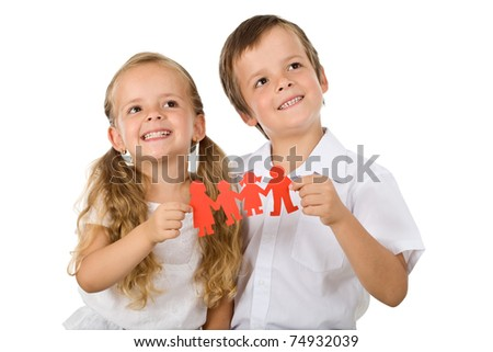 Kids holding paper people family and smiling - happy family concept - stock photo