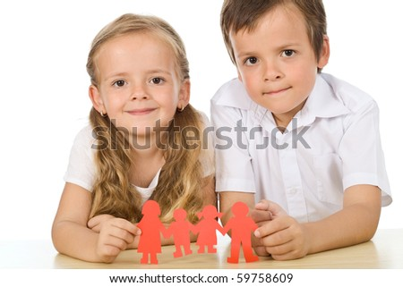 Kids holding paper people - happy family concept, isolated - stock photo