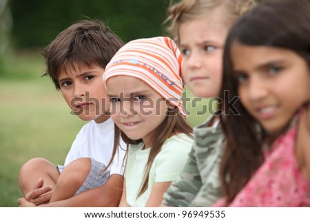 Kids in a park. - stock photo