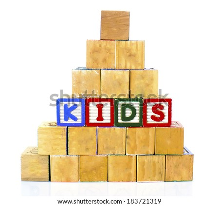 KIDS in alphabet wooden word blocks isolated on a white background                  - stock photo