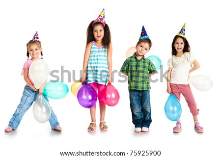 Kids in birthday caps isolated on white - stock photo