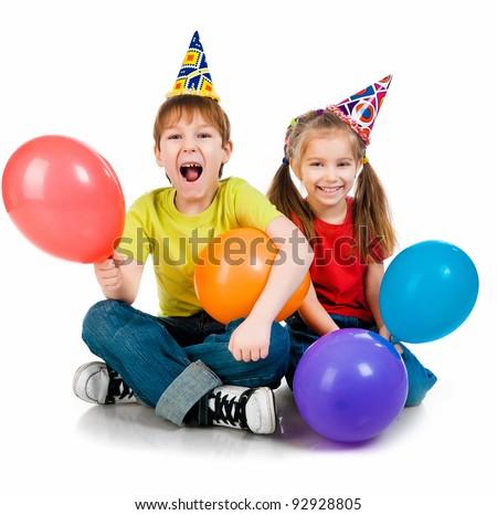 Kids in birthday caps  on white background - stock photo