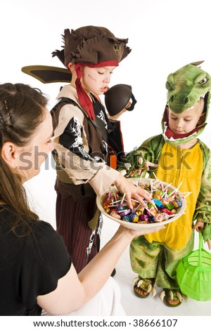 Kids in Halloween costumes playing trick or treat and asking for sweets.