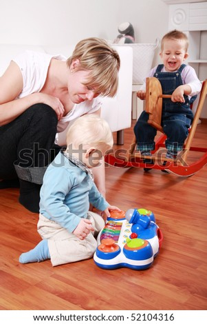 Kids in kindergarten with their teacher - stock photo