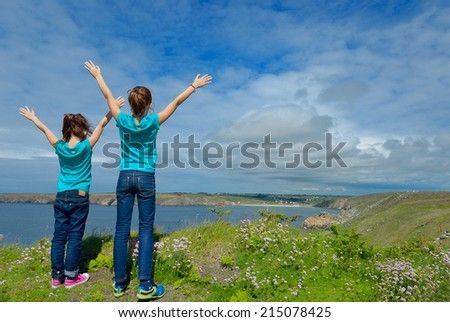 Kids looking at beautiful sea view, family hiking on vacation  - stock photo