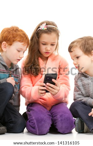 Kids looking at smartphone together. On white. - stock photo
