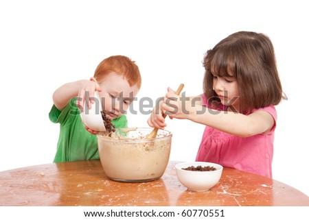 Kids mixing chocolate chip cookies - stock photo