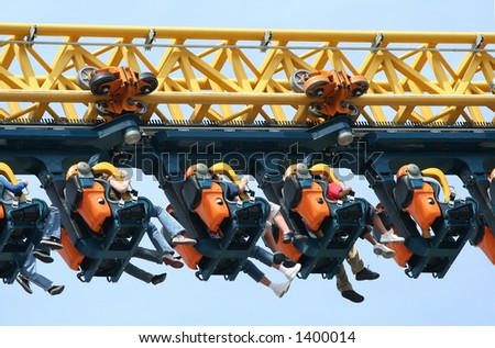 Kids on a roller coaster - stock photo