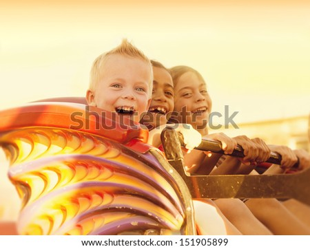 Kids on a Summertime Roller Coaster Ride - stock photo