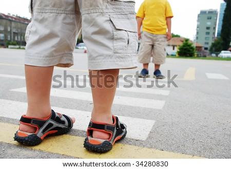 Kids on pedestrian side walk - stock photo