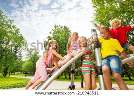 Kids on playground construction play, girl climb - stock photo