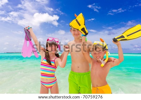 Kids on the beach - stock photo