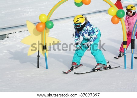 kids on the ski - stock photo