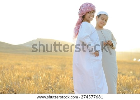Kids on wheat field - stock photo