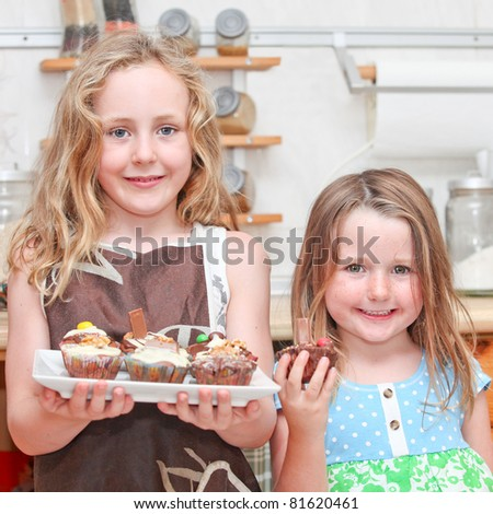kids or children cooking or baking cupcake cakes - stock photo