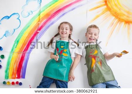 kids painting rainbow - stock photo