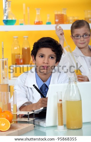Kids performing science experiment - stock photo