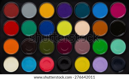kids play paint set of different colors shot close up  - stock photo