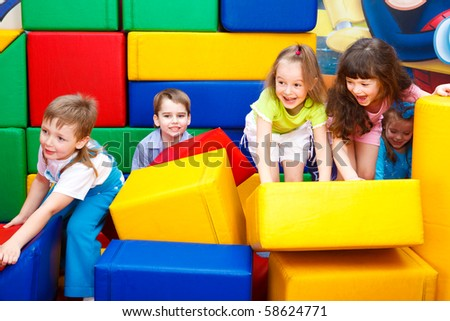 Kids play with leather bricks - stock photo
