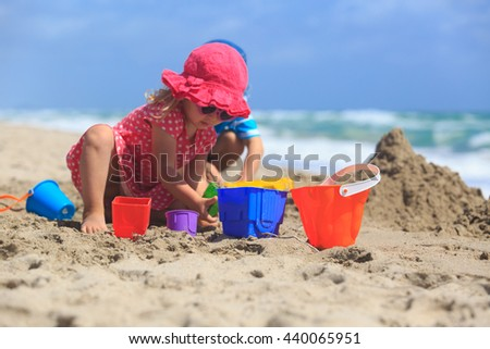 kids play with sand on summer beach - stock photo