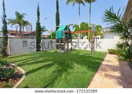 kids playground in modern australian backyard - stock photo