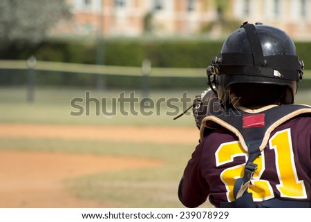 Kids playing Baseball in youth league - stock photo