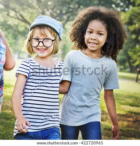 Kids Playing Cheerful Park Outdoors Concept - stock photo