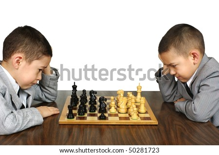 Kids playing chess, isolated on white - stock photo