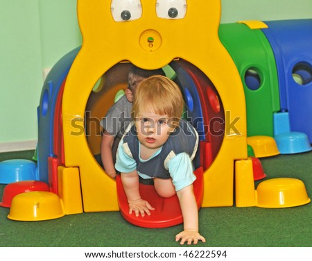 kids playing crawling in the playcentre - stock photo
