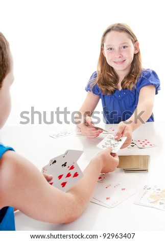 Kids playing game of cards - stock photo