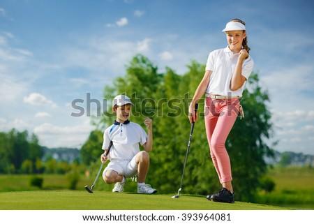Kids playing golf - stock photo